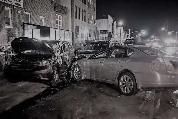 image of multiple crashed cars